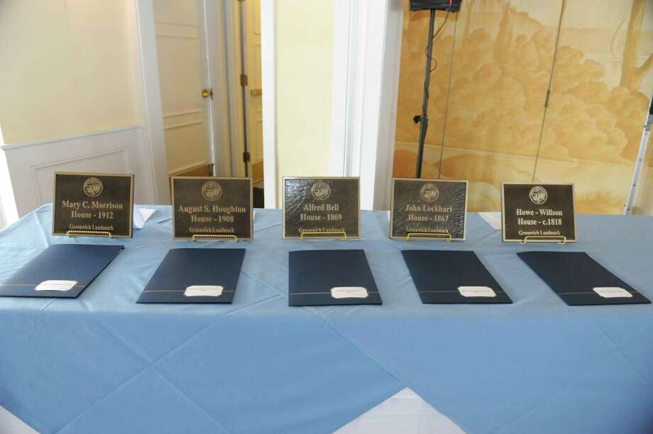 Five plaques to mark their value to Greenwich's heritage are placed on the table at Belle Haven Club  Greenwich, Sunday, April 28, 2013. Photo: Helen Neafsey / Greenwich Time