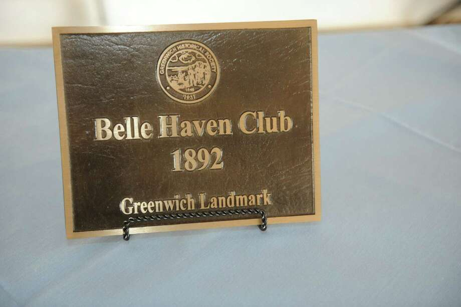 The  placque            at the Belle Haven Club at Greenwich, Sunday, April 28, 2013. The Greenwich Historical Society celebrate the 25th anniversary of its Greenwich Landmark program of recognizing houses with a reception at the Belle Haven Club, by presenting a plaque to the Club as a Greenwich landmark site for over a century. Five other structures to receive plaques to mark their value to Greenwich's heritage. Photo: Helen Neafsey / Greenwich Time