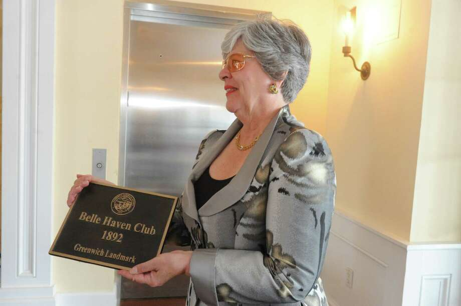 Lynne Smith presented the plaque to the Belle Haven Club at  at Greenwich, Sunday, April 28, 2013. The Greenwich Historical Society celebrate the 25th anniversary of its Greenwich Landmark program of recognizing houses with a reception at the Belle Haven Club, by presenting a plaque to the Club as a Greenwich landmark site for over a century. Five other structures to receive plaques to mark their value to Greenwich's heritage. Photo: Helen Neafsey / Greenwich Time