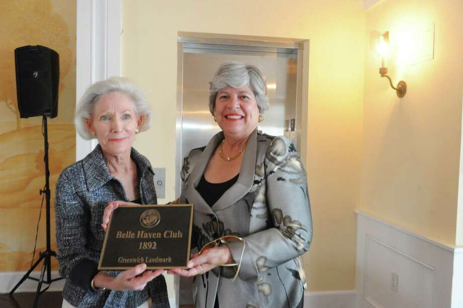 Davidde Strackbein, and  Lynne Smith present the plaque to the Belle Haven Club at Greenwich, Sunday, April 28, 2013. The Greenwich Historical Society celebrate the 25th anniversary of its Greenwich Landmark program of recognizing houses with a reception at the Belle Haven Club, by presenting a plaque to the Club as a Greenwich landmark site for over a century. Five other structures to receive plaques to mark their value to Greenwich's heritage. Photo: Helen Neafsey / Greenwich Time