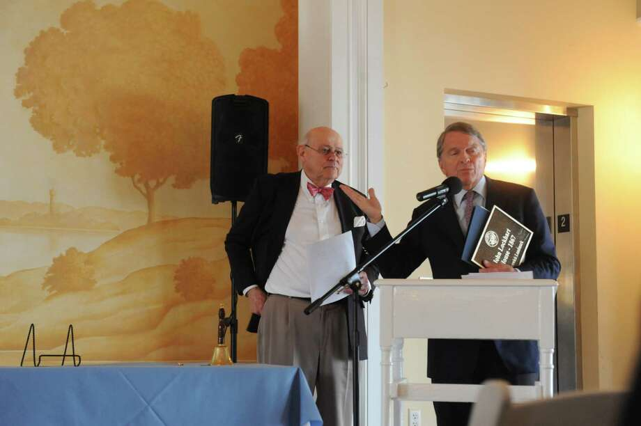Jack Morris, left, listens while David Olgilvy speaks after receiving his plaque for the John Lockhart House, 1867 at the Belle Haven Club at Greenwich, Sunday, April 28, 2013. The Greenwich Historical Society celebrate the 25th anniversary of its Greenwich Landmark program of recognizing houses with a reception at the Belle Haven Club, by presenting a plaque to the Club as a Greenwich landmark site for over a century. Five other structures to receive plaques to mark their value to Greenwich's heritage. Photo: Helen Neafsey / Greenwich Time