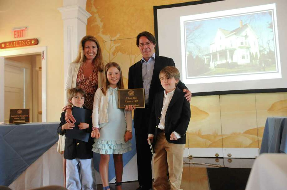 From left, Niels Kjaernested, 5,  M.E., his mother, Lija, 9, his father Gudmundur, and Thor, 7, after receiving the plaque for their Alfred Bell House, 1867 at the Belle Haven Club at Greenwich, Sunday, April 28,2013. The Greenwich Historical Society celebrate the 25th anniversary of its Greenwich Landmark program of recognizing houses with a reception at the Belle Haven Club, by presenting a plaque to the Club as a Greenwich landmark site for over a century. Five other structures to receive plaques to mark their value to Greenwich's heritage. Photo: Helen Neafsey / Greenwich Time