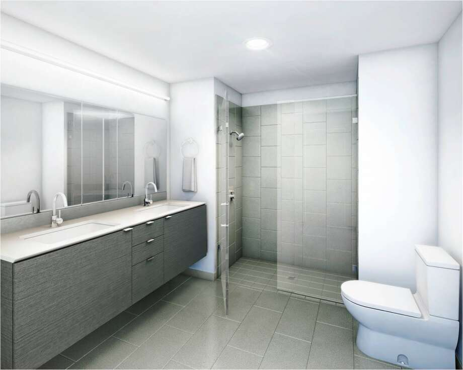 Natural walnut finished cabinets, quartz countertops and porcelain tiling? These are homes aimed at  up-market customers.