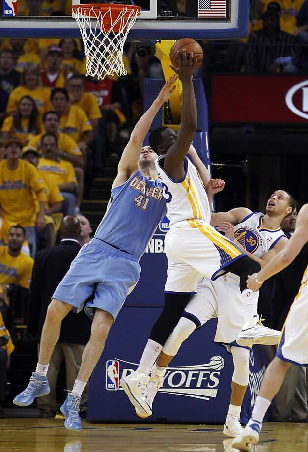 Draymond Green pulls in a rebound in the first half. The Golden State Warriors played the Denver Nuggets in Game 4 of the first round of the NBA playoffs at Oracle Arena in Oakland, Calif., on Sunday, April 28, 2013. Photo: Carlos Avila Gonzalez, The Chronicle