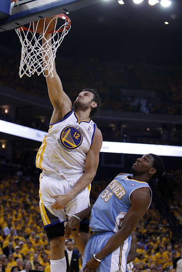 Andrew Bogut (12) dunks over Kenneth Faried (35) in the first half. The Golden State Warriors played the Denver Nuggets in Game 4 of the first round of the NBA playoffs at Oracle Arena in Oakland, Calif., on Sunday, April 28, 2013. Photo: Carlos Avila Gonzalez, The Chronicle