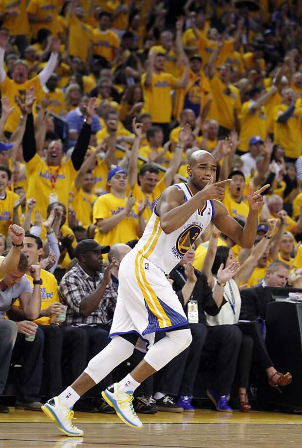 Jarrett Jack (2) reacts to hitting a three point shot in the first half. The Golden State Warriors played the Denver Nuggets in Game 4 of the first round of the NBA playoffs at Oracle Arena in Oakland, Calif., on Sunday, April 28, 2013. Photo: Carlos Avila Gonzalez, The Chronicle
