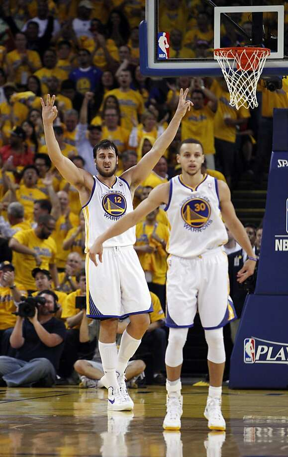 Andrew Bogut (12) signals a defense in the first half. The Golden State Warriors played the Denver Nuggets in Game 4 of the first round of the NBA playoffs at Oracle Arena in Oakland, Calif., on Sunday, April 28, 2013. Photo: Carlos Avila Gonzalez, The Chronicle