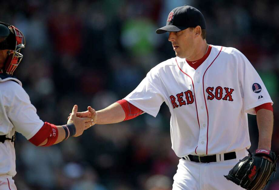 Boston Red Sox starting pitcher John Lackey, right, is congratulated by catcher Jarrod Saltalamacchia after the last out in the sixth inning of a baseball game against the Houston Astros at Fenway Park in Boston, Sunday, April 28, 2013. (AP Photo/Mary Schwalm) Photo: Mary Schwalm