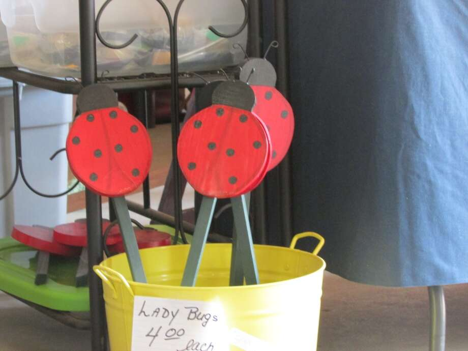 Locally, handmade ladybug lawn ornaments being sold. Photo by Erik DeFruscio.