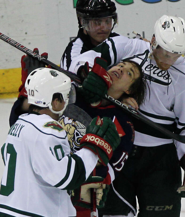 Aeros defenseman Brian Connelly, left, and winger Stephane Veilleux, right, put the squeeze on the Griffins' Mitch Callahan. Photo: Cody Duty, Staff / © 2013 Houston Chronicle