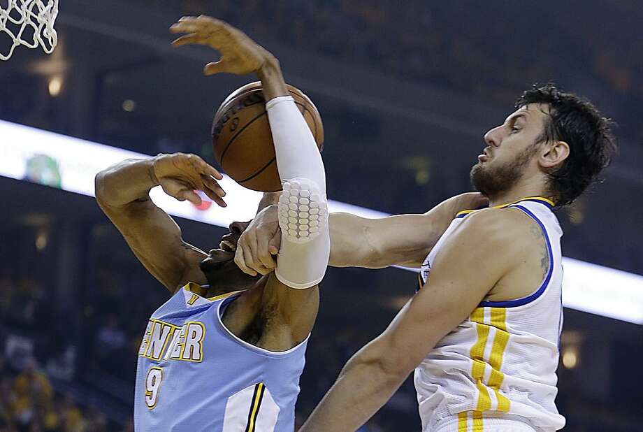 Golden State Warriors' Andrew Bogut, right, blocks the shot of Denver Nuggets' Andre Iguodala (9) during the first half of Game 4 in a first-round NBA basketball playoff series on Sunday, April 28, 2013, in Oakland, Calif. (AP Photo/Ben Margot) Photo: Ben Margot, Associated Press