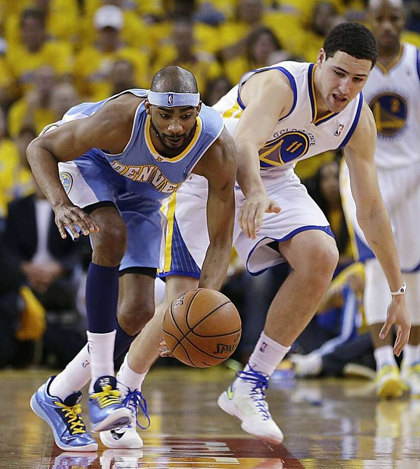 Denver Nuggets forward Corey Brewer, left, and Golden State Warriors guard Klay Thompson (11) chase a loose ball during the first half of Game 4 in a first-round NBA basketball playoff series, Sunday, April 28, 2013, in Oakland, Calif. (AP Photo/Ben Margot) Photo: Ben Margot, Associated Press
