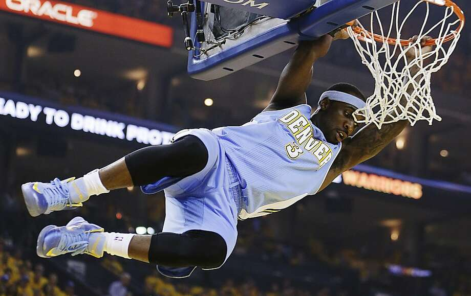 Denver Nuggets' Ty Lawson hangs on the rim after dunking against the Golden State Warriors during the first half of Game 4 in a first-round NBA basketball playoff series, Sunday, April 28, 2013, in Oakland, Calif. (AP Photo/Ben Margot) Photo: Ben Margot, Associated Press