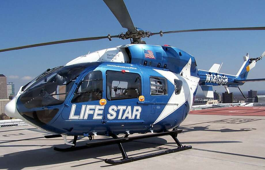 ADVANCE FOR SUNDAY APRIL 28 - In this Tuesday April 9, 2013 photo, Life Star, a helicopter used in Hartford Hospital's air medical transport program, is seen on the helipad at Hartford Hospital in Hartford Conn.  Program Aviation Services Manager and lead Pilot Edward Phillips has flown with Life Star for twenty years.  (AP Photo/Journal Inquirer, Kimberly Phillips) MANDATORY CREDIT Photo: Kimberly Phillips, Associated Press