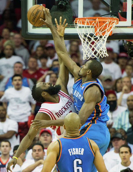 Like Serge Ibaka denying James Harden at the rim, the Thunder have risen to the occasion with Games 2  and 3 up for grabs in the late going. Photo: Smiley N. Pool, Staff / © 2013  Houston Chronicle