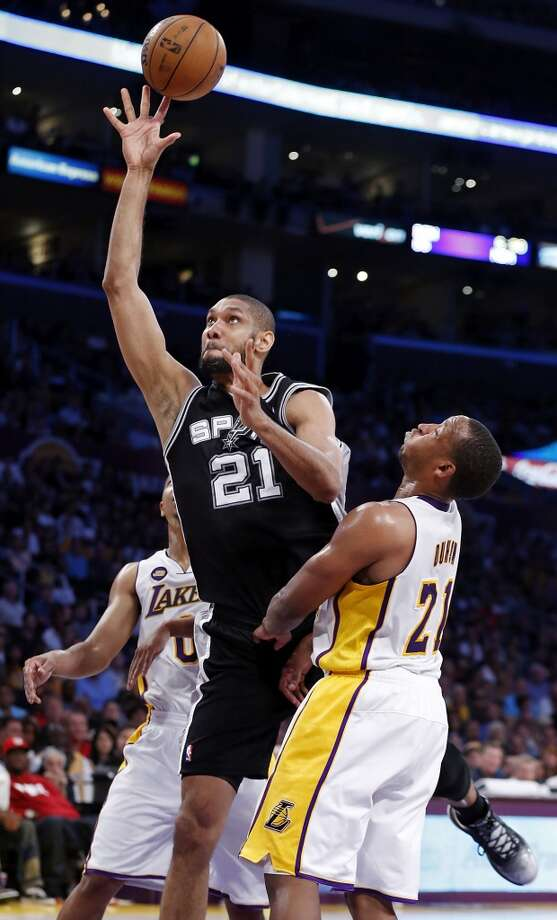 San Antonio Spurs' Tim Duncan shoots between Los Angeles Lakers' Andrew Goudelock and Los Angeles Lakers' Chris Duhon during first half action of game 4 in the first round of the NBA Playoffs Sunday April 28, 2013 at the Staples Center in Los Angeles, CA.