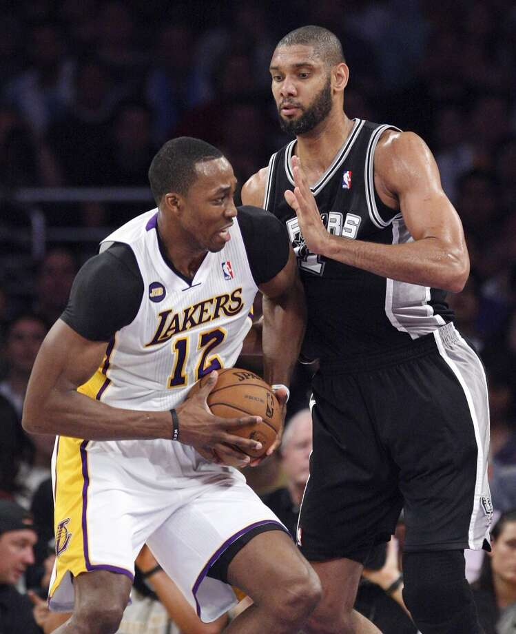 San Antonio Spurs' Tim Duncan defends Los Angeles Lakers' Dwight Howard during first half action of game 4 in the first round of the NBA Playoffs Sunday April 28, 2013 at the Staples Center in Los Angeles, CA.