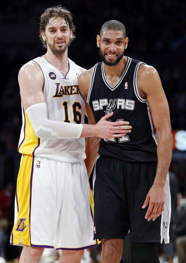 Los Angeles Lakers' Pau Gasol and San Antonio Spurs' Tim Duncan talks during second half action of game 4 in the first round of the NBA Playoffs Sunday April 28, 2013 at the Staples Center in Los Angeles, CA. The Spurs won 103-82.