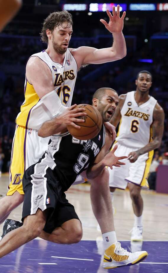 San Antonio Spurs' Tony Parker looks for room around Los Angeles Lakers' Pau Gasol during second half action of game 4 in the first round of the NBA Playoffs Sunday April 28, 2013 at the Staples Center in Los Angeles, CA. The Spurs won 103-82.