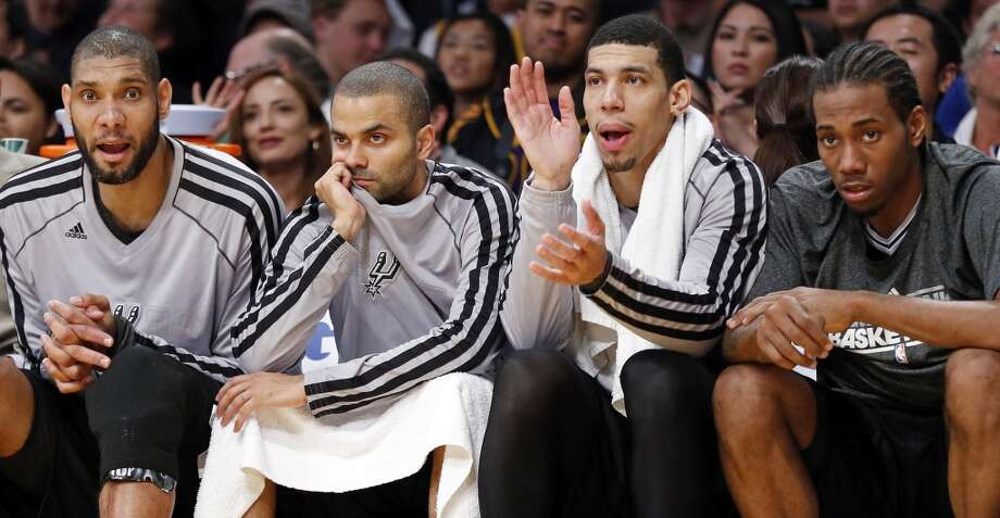 San Antonio Spurs' Tim Duncan (from left), San Antonio Spurs' Tony Parker, San Antonio Spurs' Danny Green and San Antonio Spurs' Kawhi Leonard watch second half action of game 4 in the first round of the NBA Playoffs against the Los Angeles Lakers from the bench Sunday April 28, 2013 at the Staples Center in Los Angeles, CA. The Spurs won 103-82 and will advance to the second round.