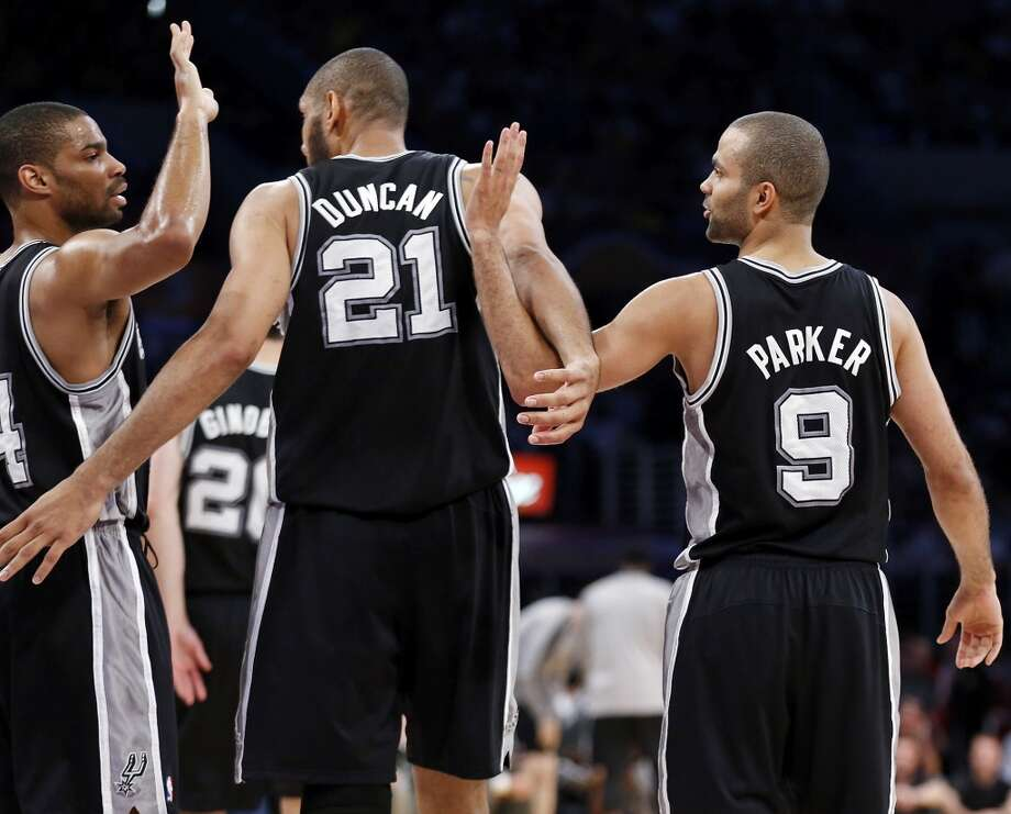 San Antonio Spurs' Gary Neal (from left) San Antonio Spurs' Tim Duncan, and San Antonio Spurs' Tony Parker react after a play during first half action of game 4 in the first round of the NBA Playoffs Sunday April 28, 2013 at the Staples Center in Los Angeles, CA.