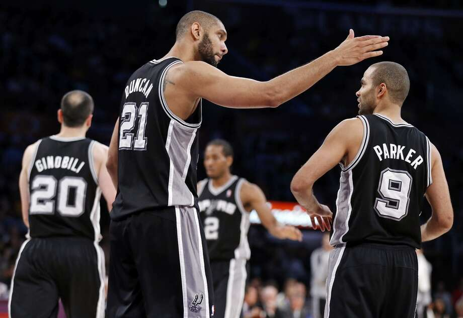 San Antonio Spurs' Tim Duncan celebrates with San Antonio Spurs' Tony Parker after a play during first half action of game 4 in the first round of the NBA Playoffs against the Los Angeles Lakers Sunday April 28, 2013 at the Staples Center in Los Angeles, CA.