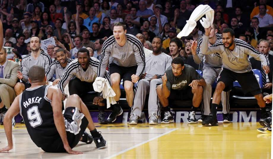 The San Antonio Spurs bench reacts after a score by teammate San Antonio Spurs' Tony Parker (front) during second half action of game 4 in the first round of the NBA Playoffs against the Los Angeles Lakers Sunday April 28, 2013 at the Staples Center in Los Angeles, CA. The Spurs won 103-82.