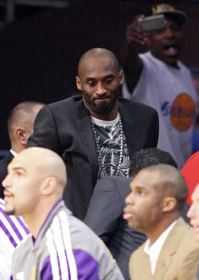 Los Angeles Lakers' Kobe Bryant (center) makes his way to the bench during second half action of game 4 in the first round of the NBA Playoffs against the San Antonio Spurs Sunday April 28, 2013 at the Staples Center in Los Angeles, CA. The Spurs won 103-82.