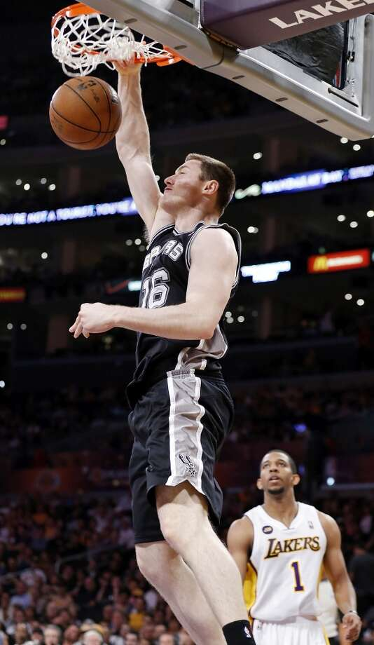 San Antonio Spurs' Aron Baynes dunks around Los Angeles Lakers' Darius Morris during second half action of game 4 in the first round of the NBA Playoffs Sunday April 28, 2013 at the Staples Center in Los Angeles, CA. The Spurs won 103-82.