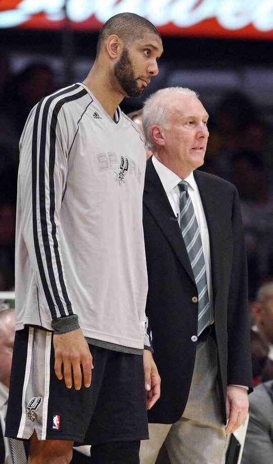 San Antonio Spurs' Tim Duncan talks with San Antonio Spurs head coach Gregg Popovich during first half action of game 4 in the first round of the NBA Playoffs against the Los Angeles Lakers  Sunday April 28, 2013 at the Staples Center in Los Angeles, CA.