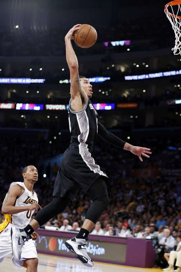 San Antonio Spurs' Danny Green goes up for a dunk around Los Angeles Lakers' Andrew Goudelock during second half action of game 4 in the first round of the NBA Playoffs Sunday April 28, 2013 at the Staples Center in Los Angeles, CA. The Spurs won 103-82.