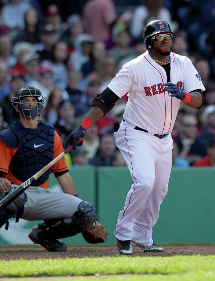 David Ortiz watches a seventh-inning double that gave the Red Sox their final run in a series in which they outscored the Astros 28-10. Photo: Mary Schwalm, FRE / FR158029 AP