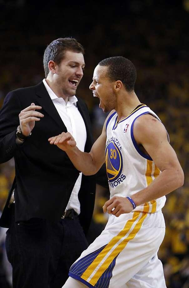 Stephen Curry (30) celebrates with David Lee after hitting a three point shot in the second half. The Golden State Warriors played the Denver Nuggets in Game 4 of the first round of the NBA playoffs at Oracle Arena in Oakland, Calif., on Sunday, April 28, 2013. Photo: Carlos Avila Gonzalez, The Chronicle