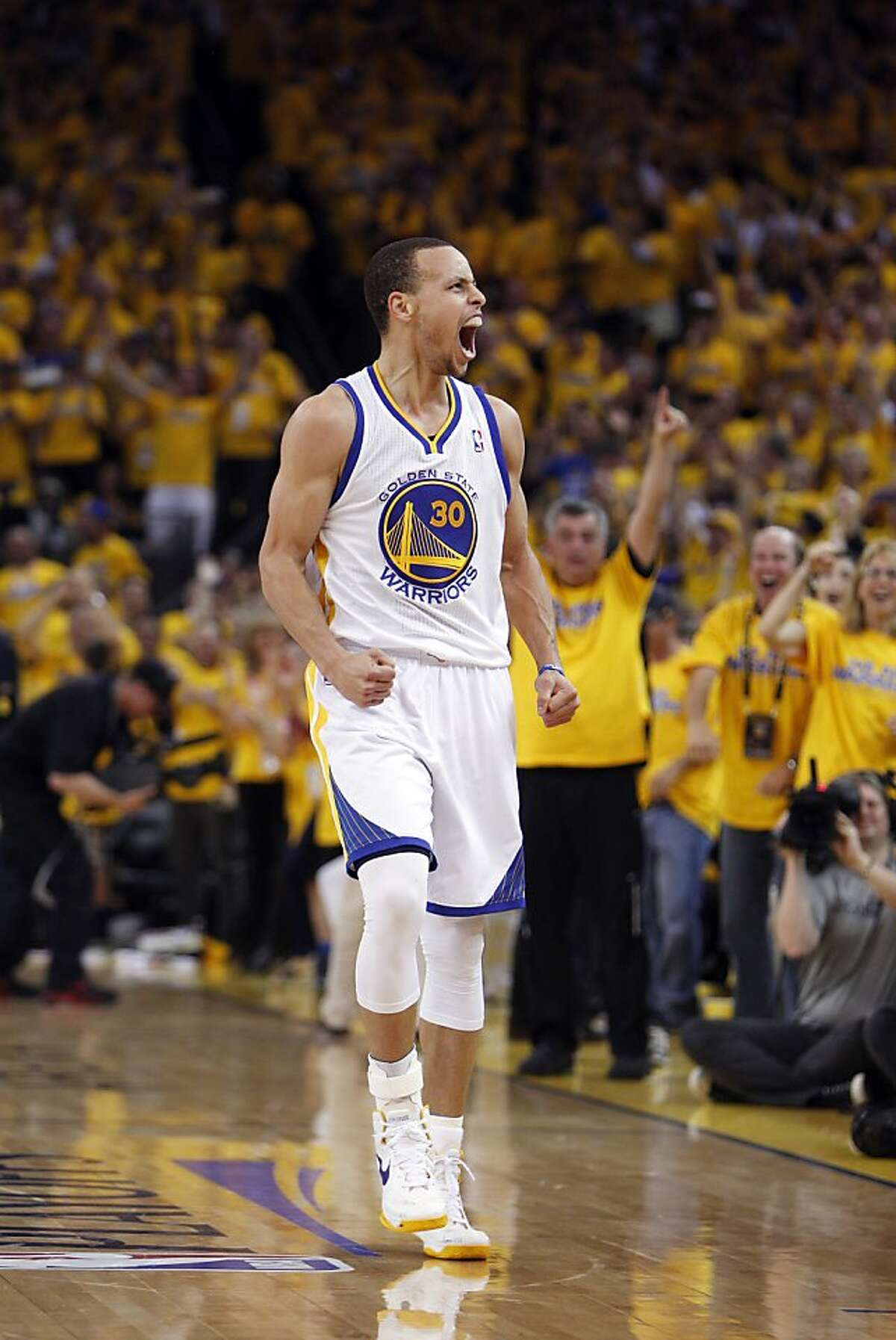 Stephen Curry (30) celebrates after hitting a three point shot in the second half. The Golden State Warriors played the Denver Nuggets in Game 4 of the first round of the NBA playoffs at Oracle Arena in Oakland, Calif., on Sunday, April 28, 2013.