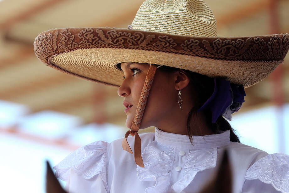 An escaramuza participant waits her turn during Fiesta Charreada put on by the San Antonio Charros Association, Sunday, April 28, 2013. Photo: Jerry Lara, San Antonio Express-News / San Antonio Express-News