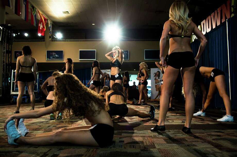 Ladies stretch before their last chance at becoming one of this upcoming season's Sea Gals during the final audition round Sunday in the West Club Lounge at CenturyLink Field in Seattle. The top 60 candidates from previous auditions started the day from an original pool of 180 women. The day's cut reduced the final number to around 30. Photo: JORDAN STEAD, SEATTLEPI.COM / SEATTLEPI.COM