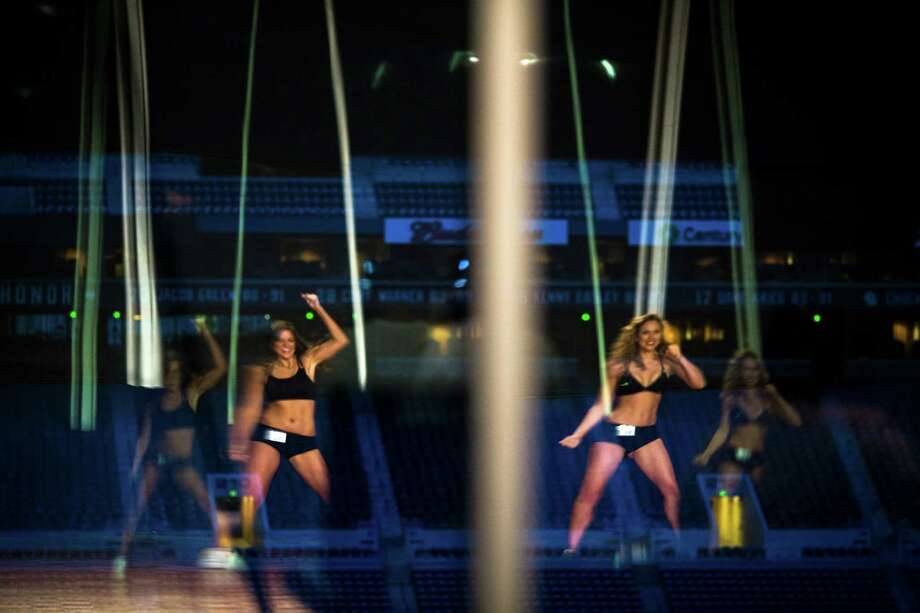 Reflected in the glass of CenturyLink Field's upper boxes, young women show off their mastery of a rehearsed two-song dance routine for their last chance at becoming one of this upcoming season's Sea Gals during the final audition round Sunday in the West Club Lounge at CenturyLink Field in Seattle. The top 60 candidates from previous auditions started the day from an original pool of 180 women. The day's cut reduced the final number to around 30. Photo: JORDAN STEAD, SEATTLEPI.COM / SEATTLEPI.COM