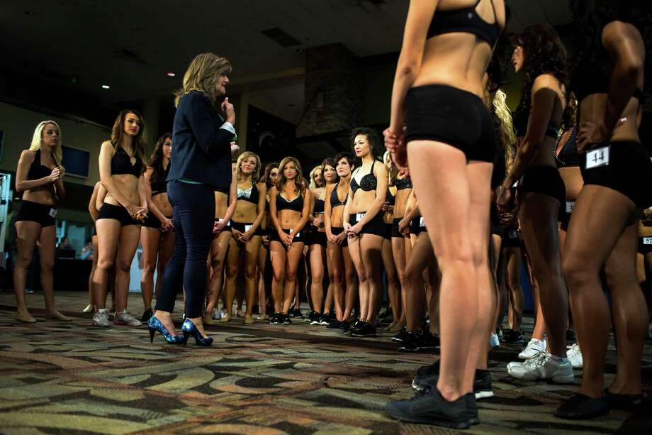 Sea Gals director Sherri Thompson, center left, welcomes young women the stage for their last chance at becoming one of this upcoming season's Sea Gals during the final audition round Sunday in the West Club Lounge at CenturyLink Field in Seattle. The top 60 candidates from previous auditions started the day from an original pool of 180 women. The day's cut reduced the final number to around 30. Photo: JORDAN STEAD, SEATTLEPI.COM / SEATTLEPI.COM