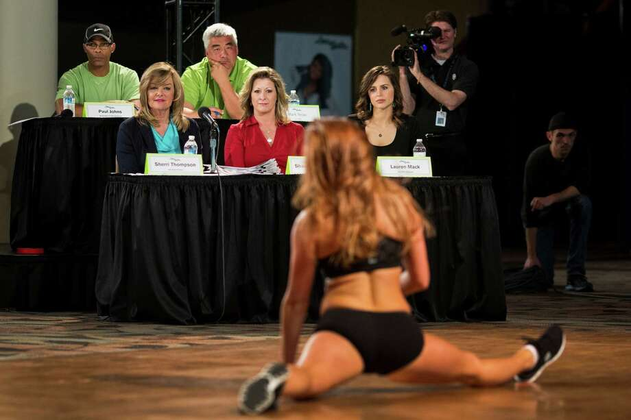 Judges review young women as they showed off their mastery of a rehearsed two-song dance routine for their last chance at becoming one of this upcoming season's Sea Gals during the final audition round Sunday in the West Club Lounge at CenturyLink Field in Seattle. The top 60 candidates from previous auditions started the day from an original pool of 180 women. The day's cut reduced the final number to around 30. Photo: JORDAN STEAD, SEATTLEPI.COM / SEATTLEPI.COM