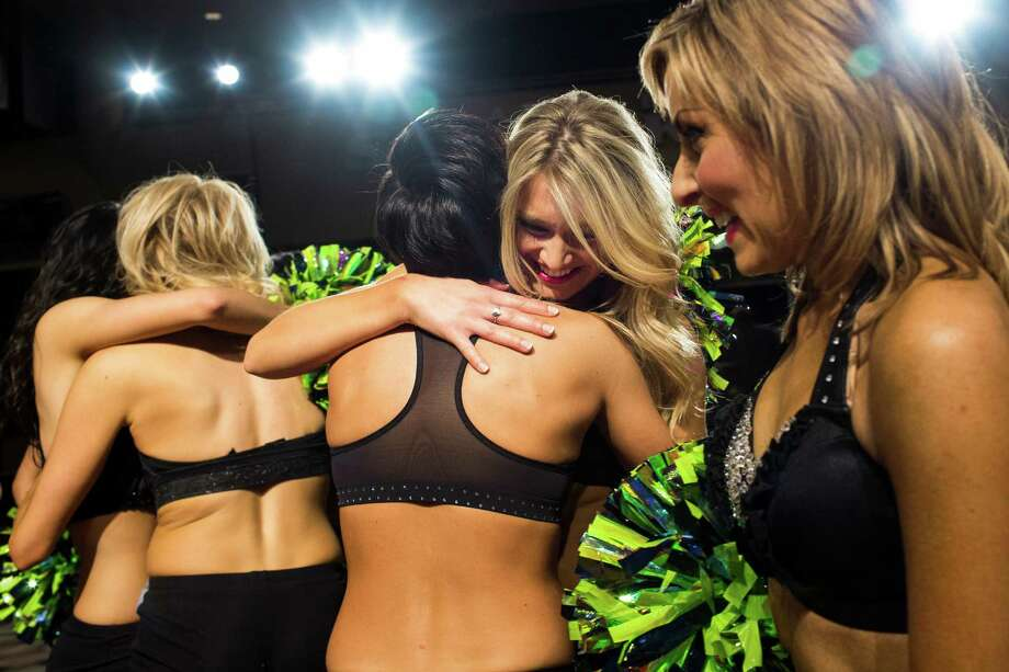 Contestants tearfully congratulate each other after being selected to become one of this upcoming season's Sea Gals after the final audition round Sunday in the West Club Lounge at CenturyLink Field in Seattle. The top 60 candidates from previous auditions started the day from an original pool of 180 women. The day's cut reduced the final number to around 30. Photo: JORDAN STEAD, SEATTLEPI.COM / SEATTLEPI.COM