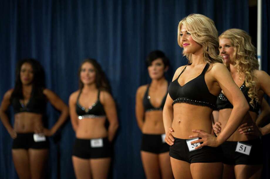 Young women show off their mastery of a rehearsed two-song dance routine for their last chance at becoming one of this upcoming season's Sea Gals during the final audition round Sunday in the West Club Lounge at CenturyLink Field in Seattle. The top 60 candidates from previous auditions started the day from an original pool of 180 women. The day's cut reduced the final number to around 30. Photo: JORDAN STEAD, SEATTLEPI.COM / SEATTLEPI.COM