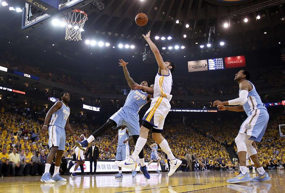 Andrew Bogut (12) pulls in a rebound in the first half. The Golden State Warriors played the Denver Nuggets in Game 4 of the first round of the NBA playoffs at Oracle Arena in Oakland, Calif., on Sunday, April 28, 2013. Photo: Carlos Avila Gonzalez, The Chronicle