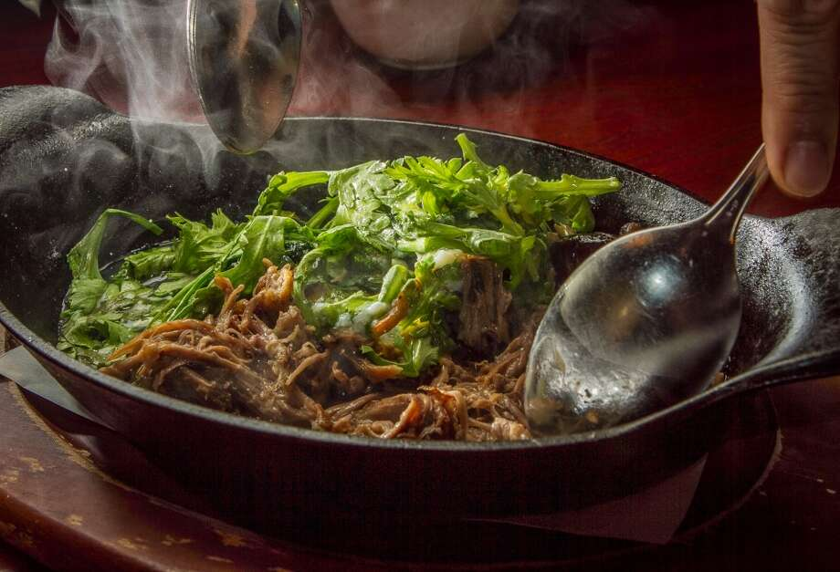 The Oxtail Hotpot is tossed at Hutong in San Francisco.