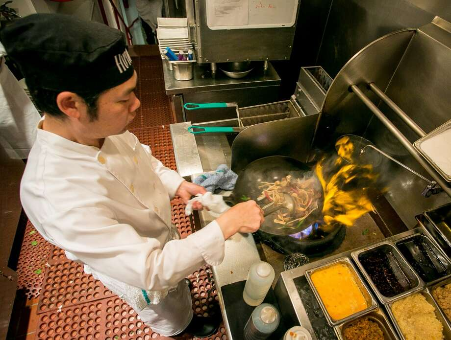 Cook Jian Xiong Huang stir-frys the hand cut noodles with wild boar at  Hutong.