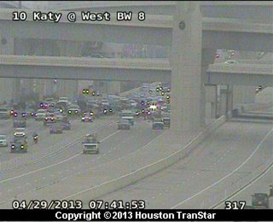 A wreck snarled traffic in the managed lanes of Interstate 10 near the Sam Houston Parkway in west Houston Monday morning. Photo: Houston Transtar