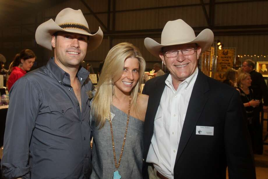 Jay and Allie Fields, from left, with Larry Senkel at the Cattle Barons Ball.