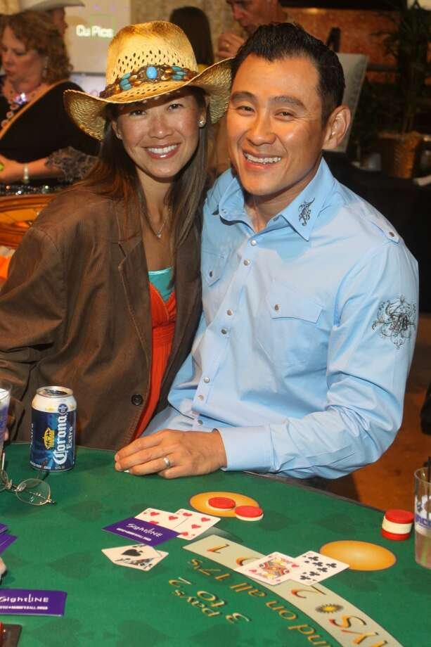 Nicole and Rick Ngo at the blackjack table at the Cattle Barons Ball.