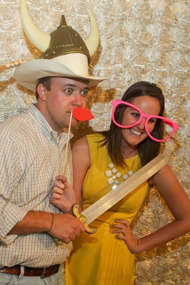 Eric Schmeltekopf and Darian Patterson pose for a photo at the CuPics photo booth at the Cattle Barons Ball.