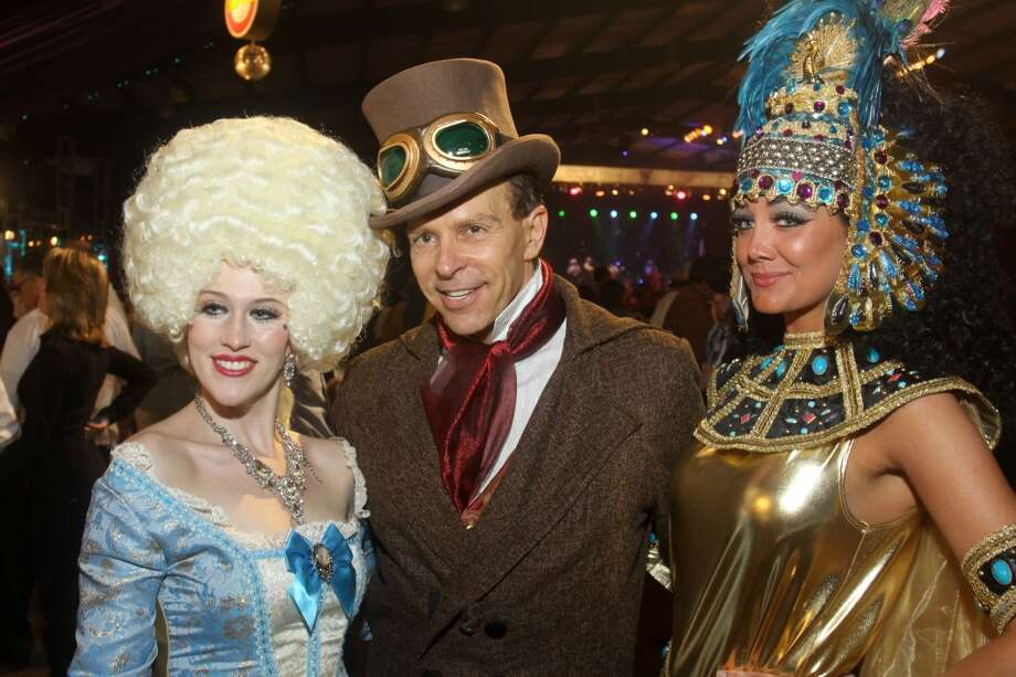 Haley Hussey as Marie Antoinette, from left, Jon Halbur as H. G. Wells, and Angela Holmes as Cleopatra, at the Cattle Barons Ball.