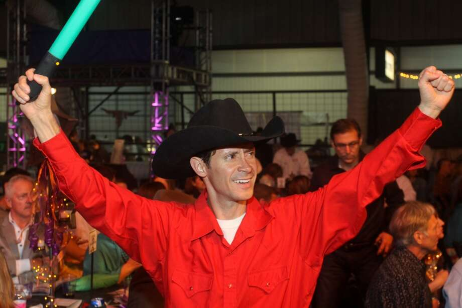 Ringman Beto Pena during the live auction at the Cattle Barons Ball.